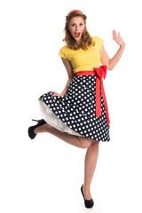 Albernes Mädchen im Rockabilly Kleid
