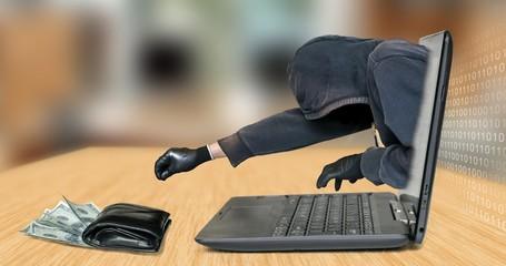 Hacker - thief steals money from laptop