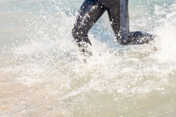 Swimmer running in the ocean