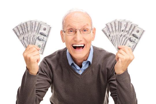 Joyful senior holding money in both hands