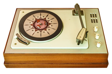 Old vinyl turntable player from the seventies isolated on white