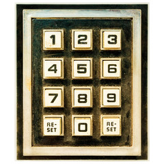 Vintage weathered keypad with reset buttons