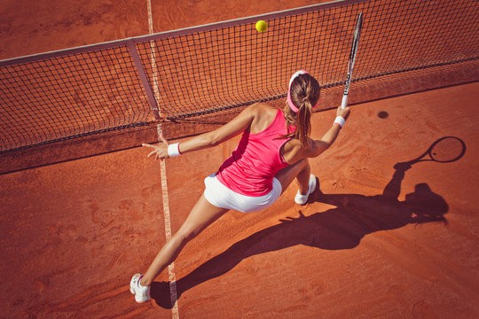 Young woman playing tennis.High angle view.Forehand volley.