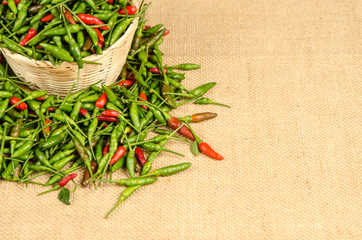 Green and red Thai chili peppers