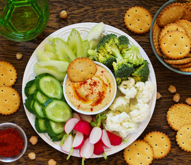 homemade hummus with raw vegetables.