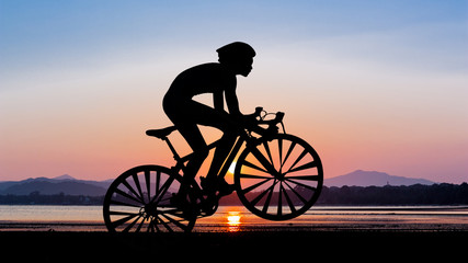 Cycling at beach on twilight time