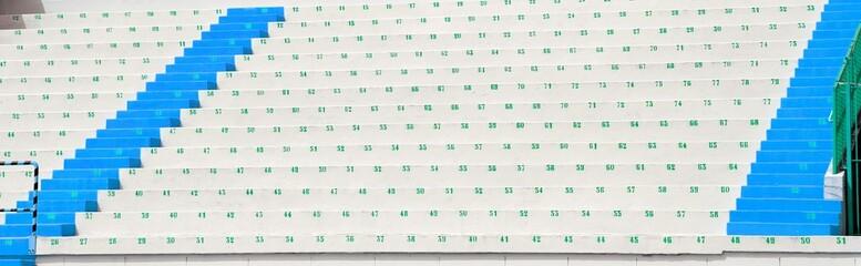 Foto op Plexiglas Stadion numbered bleachers with seats in soccer stadium