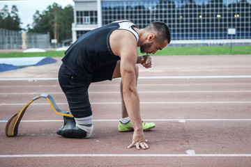 The disabled athlete preparing to start running