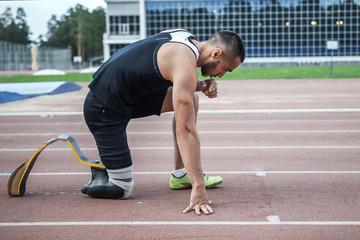 The disabled athlete preparing to start running