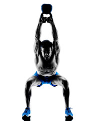man exercising fitness Kettle Bell weights exercises silhouette