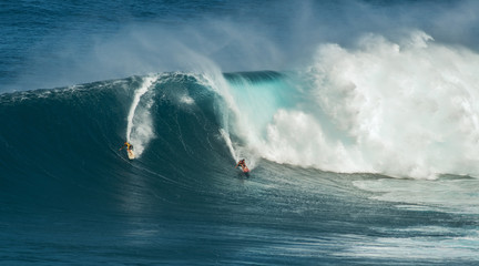 MAUI, HAWAII, USA-DECEMBER 10, 2014: Unknown surfers are riding