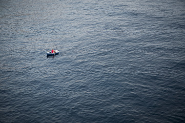 Lonely Rowboat on a Large Expanse of Sea