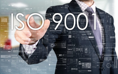the businessman is choosing ISO 9001 from touch screen