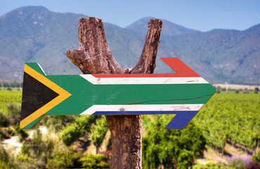 Fotobehang Zuid Afrika South Africa Flag wooden sign with vineyard background