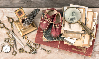 Antique books and photos, keys, writing accessories and baby sho