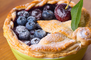 Decorated homemade shortcrust pastry berry pie with blueberries