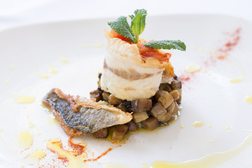 Tasty dish with fish and aubergine