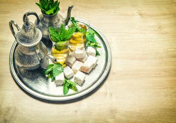 Mint tea with arabic delight. Oriental hospitality. Vintage styl