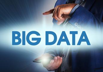 Businessman presses button big data on virtual screens. Business