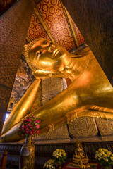 Sleeping golden Buddha statue in the church of Wat Pho, Thailand