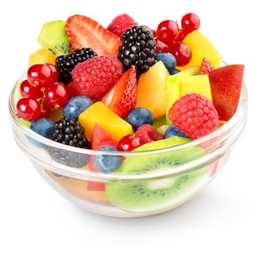 close up of a colorful fruit salad isolated on white