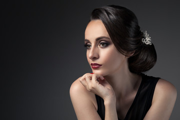 Beautiful Woman. Fashion Festive Coiffure with Pearls. Upsweep.