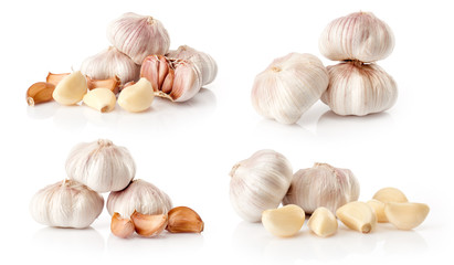 composite of fresh garlic  isolated on white background