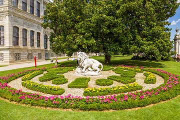 Istanbul, Turkey. The picturesque bed and sculpture of a lion in the Dolmabahce Palace