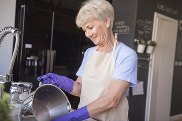 Senior woman washing the dishes