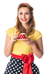 Lächelndes Pinup Girl trinkt Kaffee