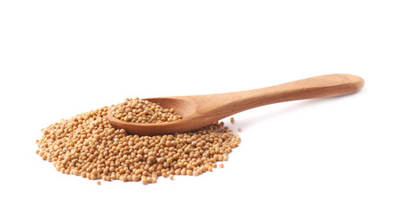Wooden spoon and brown mustard seeds