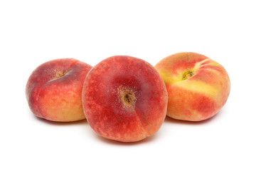 Three ripe peach close-up on a white background
