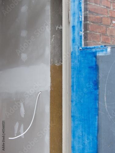 nacktes kabel aus der wand eines altbaus in der sudbrackstra e in bielefeld schildesche. Black Bedroom Furniture Sets. Home Design Ideas