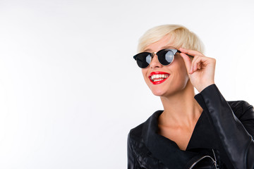 successful beautiful young woman with red lips adjusting her gla