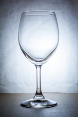 Empty wine glass in cool tone