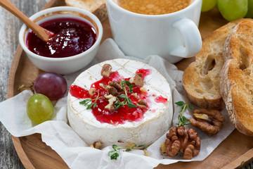 gourmet breakfast- camembert with berry jam, toast, coffee