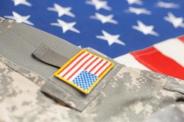 USA flag with army uniform - close up studio shot