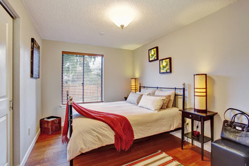 Georgous master bedroom with hardwood floor.