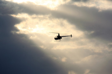 helicopter in sunbeam, Hawaii, USA