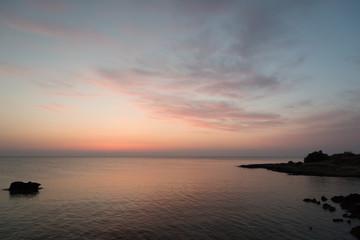 Rocky sea coast right before sunrise