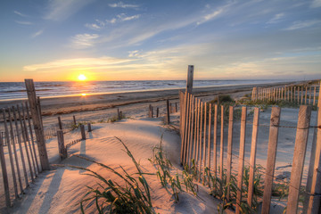 Photo Blinds Beach Sunrise as seen from the sand dunes at the Outer Banks, NC around Corolla Beach in September, 2014.