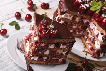 Holiday sliced cherry cake on a plate close-up. Horizontal