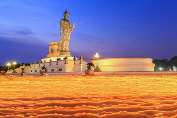 Makha Bucha Day, Candle lit from buddhists are moving around Buddha statue at the Phutthamonthon district, Nakhon Pathom Province of Thailand