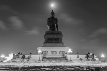 Makha Bucha Day, Candle lit from buddhists are moving around Buddha statue at the Phutthamonthon district, Nakhon Pathom Province of Thailand. Black and White