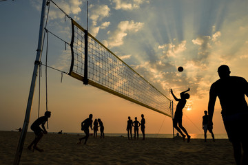 Wall Mural - Beach volleyball silhouette at sunset , motion blurred