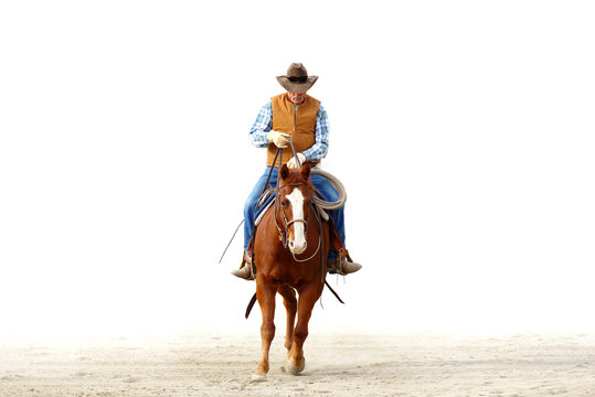 Mountain cowboy riding his horse in the dirt with a blank white background for text..