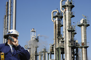 oil and gas worker, large refinery pipelines and towers
