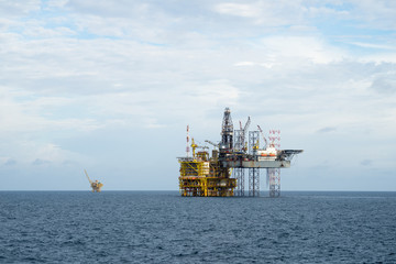 Drilling operation between Jack up and Oil processing platform at sea
