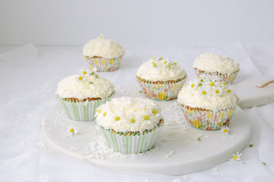 Plate of cupcakes decorated with flowers