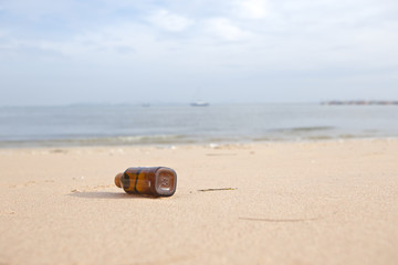 Place the bottle on the beach